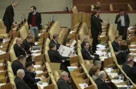 FILE - Russian lawmakers attend a session of the lower house of the State Duma in Moscow, Russia.