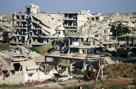 A picture taken on June 1, 2018 shows a view of destroyed buildings in a rebel-held area in the southern Syrian city of Daraa.