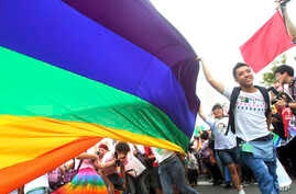 FILE - Participants revel through a street during a gay and lesbian parade in Taipei, Taiwan.