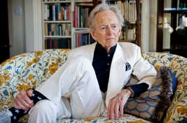FILE - American author and journalist Tom Wolfe, Jr. appears in his living room during an interview in New York, July 26, 2016.