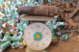Bomb on scales at scrap yard. (VOA/M. Brown)