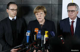 German Chancellor Angela Merkel, Justice Minister Heiko Maas (left) and Interior Minister Thomas de Maiziere during a statement after visiting the Bundeskriminalamt Federal Crime Office Police in Berlin, Germany, Dec. 22, 2016.