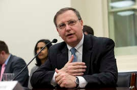 Acting Drug Enforcement Administration (DEA) Administrator Chuck Rosenberg talks before he testifies on Capitol Hill in Washington, March 22, 2016, before a House Appropriations subcommittee hearing on the DEA's fiscal 2017 budget request.