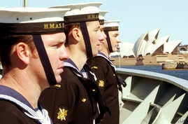 FILE - Sailors onboard Australia's HMAS Stuart line the upper decks as the ship sails towards the Sydney Opera House on returning from duty in the Middle East, Sept. 10, 2004.