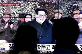 People walk by a TV news program showing North Korean leader Kim Jong Un in Seoul, South Korea, Friday, March 4, 2016.