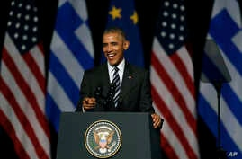 U.S. President Barack Obama laughs as he delivers a speech at the new opera of Athens on Nov. 16, 2016.