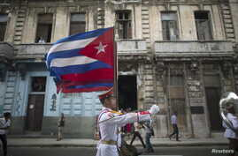 Cuban soldiers march during a ceremony in Havana Nov. 27, 2015.