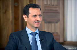 Syrian President Bashar al-Assad railed against foreign interference in an interview with al-Manar. Syria's national news agency SANA distributed a photo from the interview, Aug. 25, 2015.