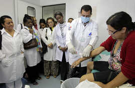 A group of Cuban doctors attend a training session at a health clinic in a low-income neighborhood in Brasilia, Brazil, Friday, Aug. 30, 2013.