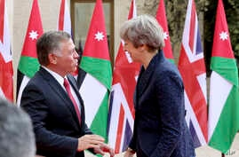 JBritish Prime Minister Theresa May meets King Abdullah at the Royal Palace in Amman, Jordan, during her visit to the Middle East, Nov. 30, 2017.