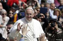 Pope Francis waves as he leaves after the Palm Sunday mass at Saint Peter's Square at the Vatican, March 24, 2013.