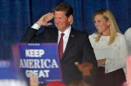 Republican candidate for Georgia Governor Brian Kemp reacts as he and his wife Marty step on stage for a rally, Nov. 4, 2018, in Macon, Ga.