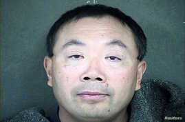 FILE - Zhang Weiqiang is shown in this Wyandotte County, Kansas, Detention Center handout photo released to Reuters Dec. 12, 2013. Zhang is one of two agricultural scientists from China who were charged with trying to steal samples of a variety of se