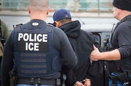 FILE - U.S. Immigration and Customs Enforcement (ICE) agents make an arrest in in Los Angeles, Feb. 7, 2017.