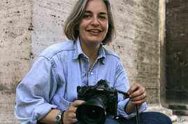 FILE - Associated Press photographer Anja Niedringhaus poses for a photograph in Rome. Niedringhaus, 48, was killed and an AP reporter was wounded on Friday, April 4, 2014 when an Afghan policeman opened fire while they were sitting in their car in e