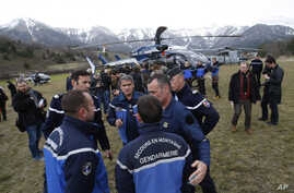 Rescue workers and gendarme gather in Seyne-les-Alpes, French Alps as search-and-rescue teams struggle to reach the remote crash site of Germanwings passenger plane, March 24, 2015.