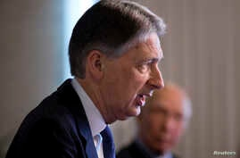 British Foreign Secretary Phillip Hammond, left speaks during a joint news conference with Pakistan Foreign Affairs Adviser Sartaj Aziz at the Foreign Ministry in Islamabad, Pakistan, Tuesday, March 8, 2016.