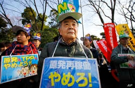 Protesters stage an anti-nuclear plant demonstration outside the national diet building in Tokyo, March 9, 2014.