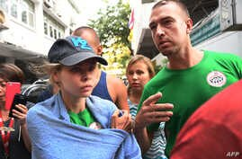 Belarusian model Anastasia Vashukevich, known by her pen name Nastya Rybka, and Alex Kirillov leave the Thai immigration department in Bangkok, Jan. 17, 2019, during their deportation together with other associates after pleading guilty in court to m