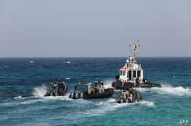 Members of Libya's naval coastguard man speed boats as they wait for the arrival of the Morning Glory, an oil tanker that US Navy handed over to Libyan authorities on March 22, 2014 at Zawiya port, Libya.