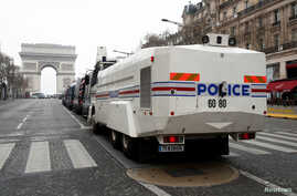 "A French police water canon vehicle is in place on the Champs-Elysees avenue during the the 19th consecutive national protest Saturday of the ""yellow vests"" movement in Paris, March 23, 2019."