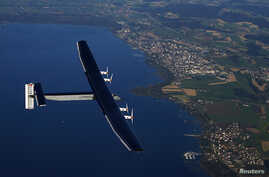 German test pilot Markus Scherdel steers the solar-powered Solar Impulse 2 aircraft over the Lake Murten during a training flight at its base in Payerne September 27, 2014.