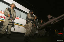 Indonesia's anti-terror police stand guard at the site of a shooting at a hotel in Sanur on the Indonesian island of Bali, March 18, 2012.