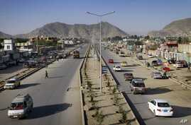 Vehicles cross on a newly constructed Darul Aman streets in Kabul, Afghanistan,  April 21, 2011