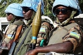 The blue helmets of UN peacekeepers distinguish them from the many armed groups in Darfur