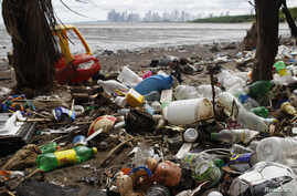 Discarded toys are seen amongst trash, on a beach near the high-income Costa del Este neighbourhood in Panama City