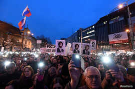 "Demonstrators attend a protest called ""Let's stand for decency in Slovakia"" in reaction to the murder of Slovak investigative reporter Jan Kuciak and his fiancee, Martina Kusnirova, in Bratislava, Slovakia, March 9, 2018."