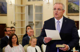 New Australian Prime Minister Scott Morrison is seen at his swearing-in ceremony as his wife Jenny looks on, in Canberra, Australia, Aug. 24, 2018.