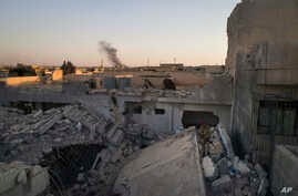 An Iraqi soldier stands atop a destroyed house in a neighborhood recently retaken by Iraqi security forces during fighting against Islamic State militants in west Mosul, Iraq, June 25, 2017.