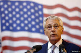 U.S. Defence Secretary Chuck Hagel addresses a joint media briefing with Romania's Defense Minister Mircea Dusa (not pictured) in the Black Sea port of Constanta June 5, 2014.