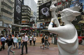 A statue of the Goddess of Democracy, which symbolizes the 1989 pro-democracy movement in Beijing,  is displayed at a downtown street in Hong Kong, June 3, 2014, to mark the 25th anniversary of China's bloody crackdown on Tiananmen Square on June 4.
