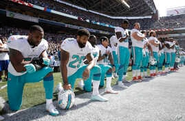 Jelani Jenkins, Arian Foster, Michael Thomas and Kenny Stills kneel during the national anthem, Sept. 11, 2016.