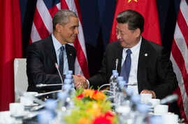 President Barack Obama (L) shakes hands with Chinese President Xi Jinping during their meeting on the sidelines of the United Nations Climate Change Conference, in Le Bourget, outside Paris, Nov. 30, 2015.
