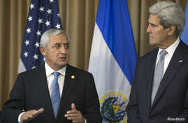 Guatemala's President Otto Perez Molina, left, and U.S. Secretary of State John Kerry discuss immigration while in Panama City July 1, 2014.