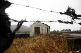 FILE - The old disused border post on the border between the Republic of Ireland and Northern Ireland near Jonesborough, Northern Ireland, Jan. 30, 2017.