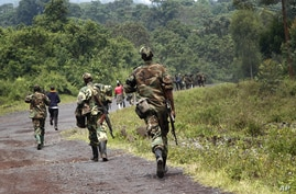A column of Congolese M23 rebels on the Goma to Rushuru road, near Kibumba, north of Goma, DRC, November 27, 2012.