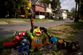 A makeshift memorial of stuffed animals decorates a South Side street corner, Aug. 21, 2017, in Syracuse, N.Y. The memorial was created for 15-year-old Akil Williams, who was shot earlier this summer. From 2014 through this past June, 48 youths aged