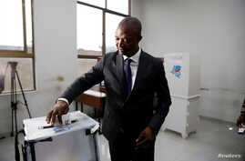 Emmanuel Ramazani Shadary, former Congolese Interior minister and presidential candidate, casts his vote at a polling station in Kinshasa, Democratic Republic of Congo, Dec. 30, 2018.