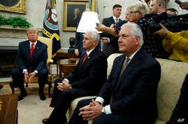 President Donald Trump listens to a question during a meeting with Finnish President Sauli Niinisto in the Oval Office of the White House in Washington, Aug. 28, 2017. From left are, Trump, Vice President Mike Pence, and Secretary of State Rex Tiller