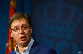 Serbian Prime Minister Aleksandar Vucic speaks during a press conference, in Belgrade, Serbia, Oct. 30, 2016. Vucic and his family were moved to a safe location after a cache of weapons was found Saturday near his residence outside Belgrade.