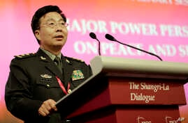 """Wang Guangzhong, China's Deputy Chief, General Staff Department, delivers his speech on """"Major Power Perspectives on Peace and Security in the Asia-Pacific"""", in Singapore during the Asia Security Summit, June 1, 2014.."""
