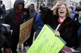 Supporters of the late Michael Brown confront Pattie Canter, right, who backs police officer Darren Wilson, in a street demonstration in Clayton, Missouri, Nov. 17, 2014.