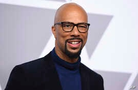 FILE - Common arrives at the 90th Academy Awards Nominees Luncheon in Beverly Hills, California, Feb. 5, 2018. Common showed up at P.S. 111 in midtown Manhattan on Thursday as an ambassador for the Adopt-A-Classroom initiative.