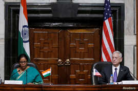 India's Defense Minister Nirmala Sitharaman (L) speaks as U.S. Defense Secretary Jim Mattis looks on during a joint news conference in New Delhi, India Sept. 26, 2017.