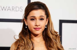 FILE - Singer Ariana Grande arrives at the 56th annual Grammy Awards in Los Angeles, California.