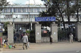 Pedestrians walk past the Federal High Court building in Addis Ababa